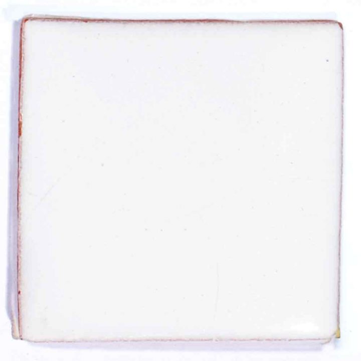 puro white hand made inset tile.